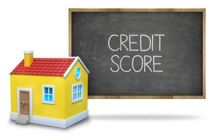 Credit score text on blackboard with 3d house front of blackboard on white background